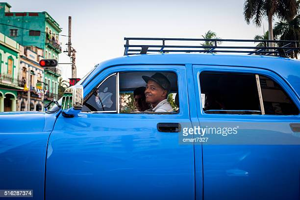Young Cubans Smile at a Stoplight