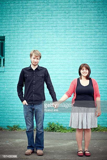 Young Cute Couple Holding Hands