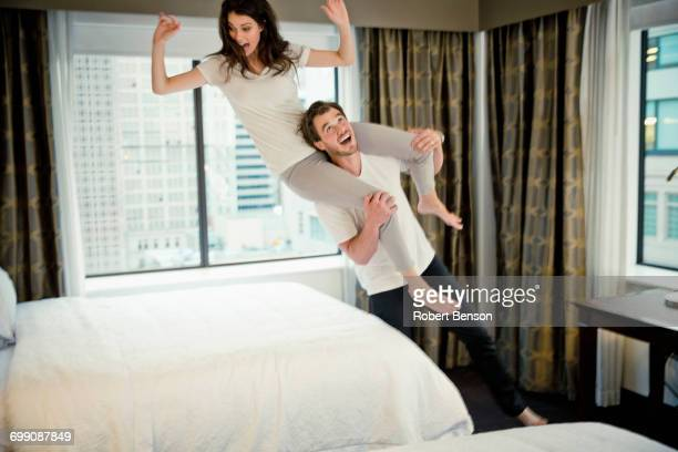A Young Cute Couple Plays In A Dallas Hotel Room