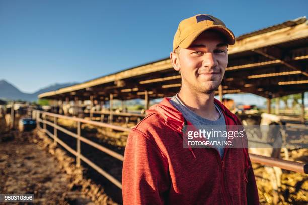 young dairy farmer - baseball cap stock pictures, royalty-free photos & images