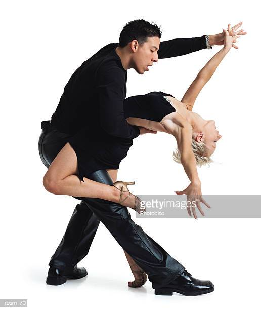 young dance couple latin male and a caucasian blonde both in a black hold each other in a tango pose - clubkleding stockfoto's en -beelden