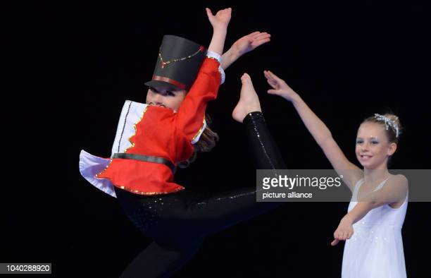 Young dancer Charlett Wiese and Alissa Stolle from Germany compete in the preliminaries of the World Show Dance Championships in Riesa Germany 25...