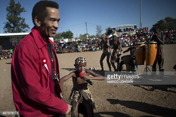 A young dancer from a traditional dance group invites incumbent Botswana President Seretse Ian Khama to dance in front of the crowd of supporters of...