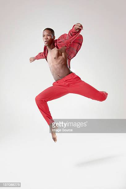 Young dancer in mid air