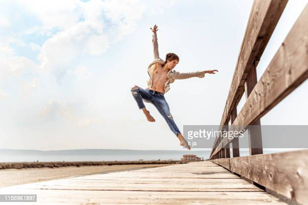 young dancer on a wooden pier - fully unbuttoned stock pictures, royalty-free photos & images