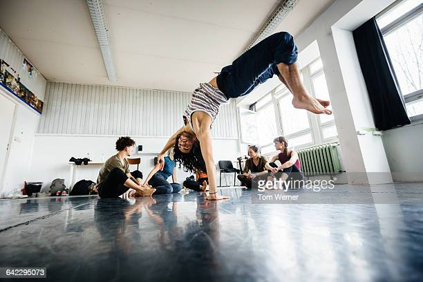 young dancer performing in a dancing studio - acrobatic activity stock photos and pictures