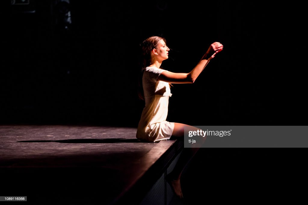 Young dancer performing on a theater stage : Stock Photo