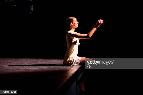 young dancer performing on a theater stage - acting performance stock pictures, royalty-free photos & images