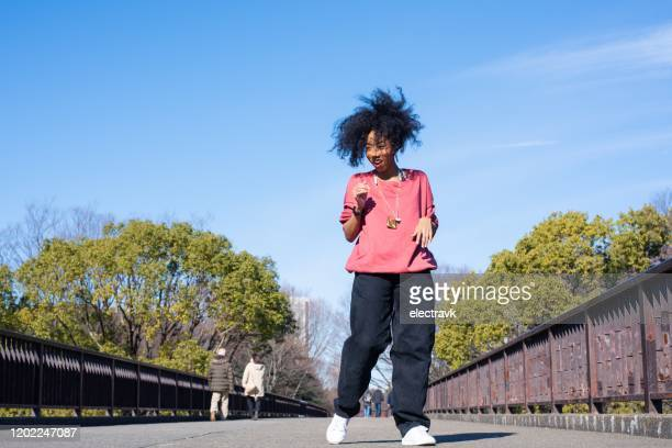 young dancer practicing outside - showus stock pictures, royalty-free photos & images