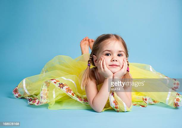 Young Dancer Sitting on Belly Looking at Camera