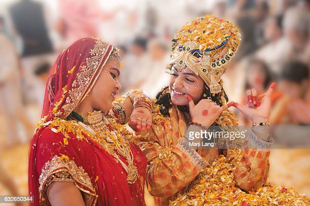 Young dancers couple as Radha and Krishna during Holi festival in Jaipur Rajasthan India