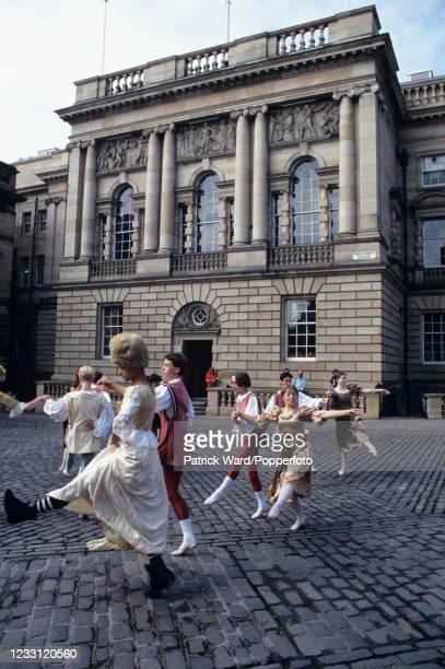 """Young dancers during a performance of """"Cinderella"""" in Parliament Square during the Edinburgh Festival in Scotland, circa September 1998."""
