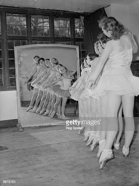 Young dancers of the Imperial Theatre of St Petersburg and Moscow rehearsing before a mirror at Seer Green, Buckinghamshire, in preparation for their...