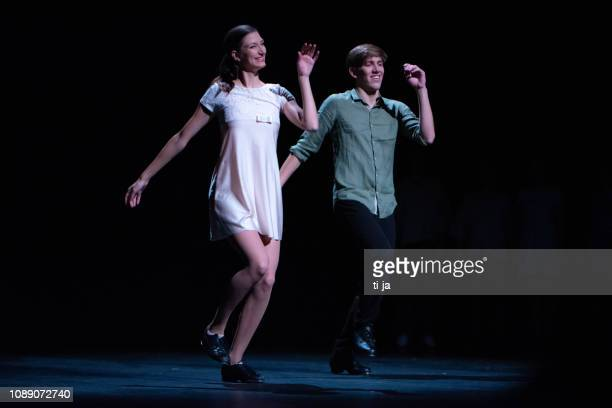 young dancers performing on a theater stage - acting performance stock pictures, royalty-free photos & images