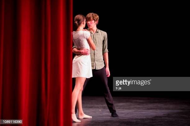 young dancers performing on a theater stage - actor stock pictures, royalty-free photos & images