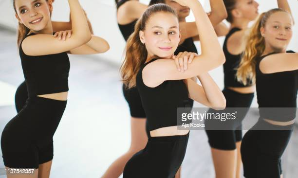 young dancers practice for their dance performance. - performing arts center stock pictures, royalty-free photos & images
