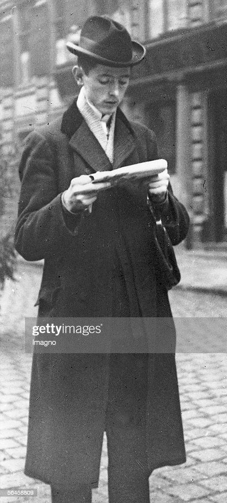 Young dandy, called Gigerl in Vienna, reading a newspaper