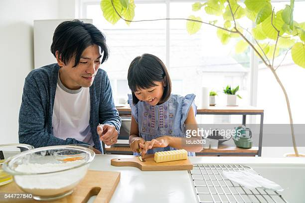 Young daughter baking with father