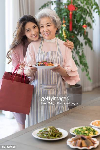 Young daughter visiting her mother during Chinese new year