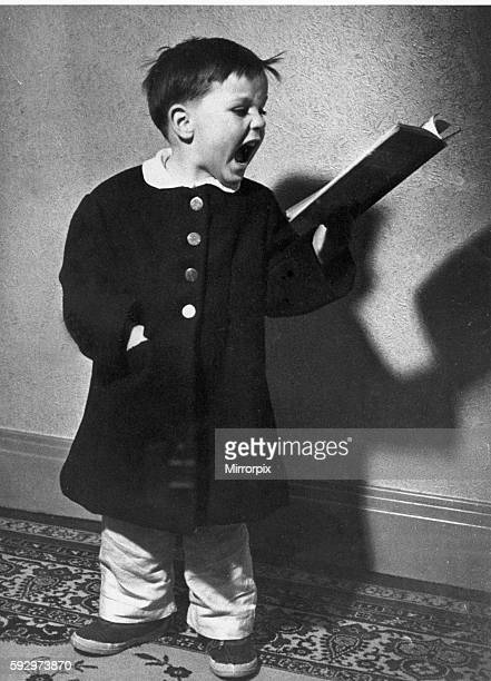 Young David Lea aged 3 and a half practicing Christmas carols at home 17th November 1952