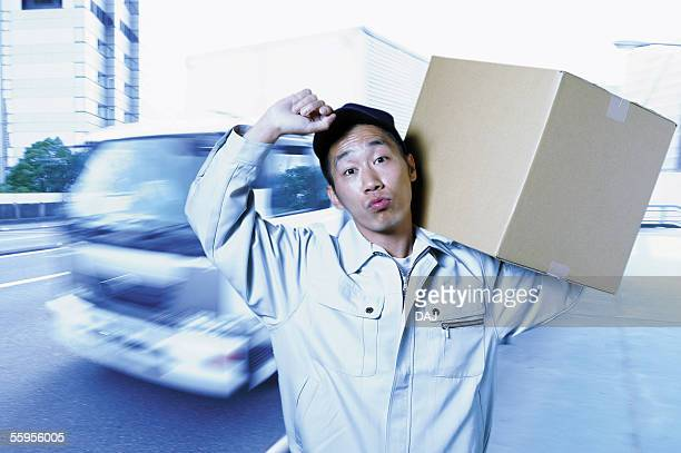 Young Delivery Man Carrying Package