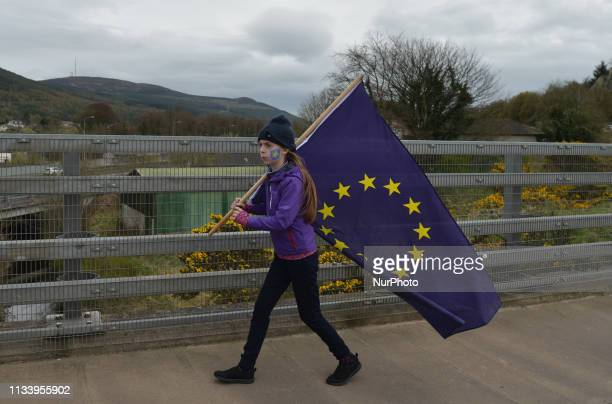 A young demonstrator arrives a Border Communities Against Brexit protest as part of their ongoing campaign against the return of a border to the...