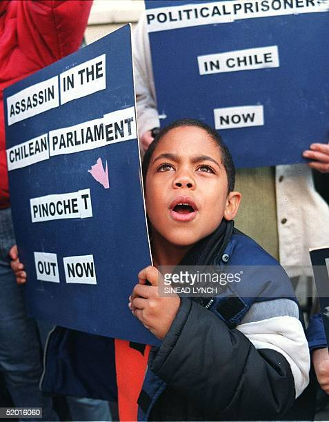 A young demonstrator shouts slogans 17 October at the entrance of The London Clinic hospital where former dictator Augusto Pinochet is recovering...