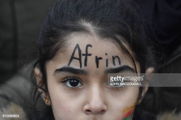 TOPSHOT A young demonstrator with the word 'Afrin' painted on his face takes part to a demonstration to protest against the ongoing Turkish military...