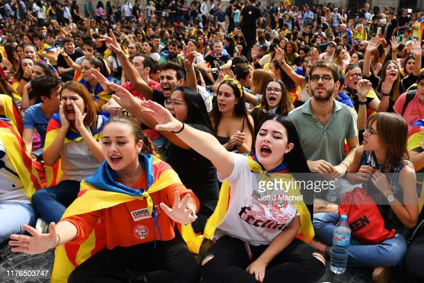 Young demonstrators gather following a week of protests over the jail sentences given to separatist politicians by Spain's Supreme Court on October...