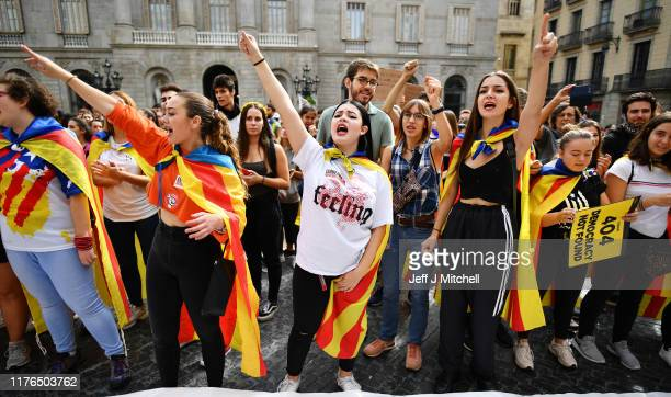 Young demonstrators gather following a week of protests over the jail sentences given to separatist politicians by Spain's Supreme Court, on October...
