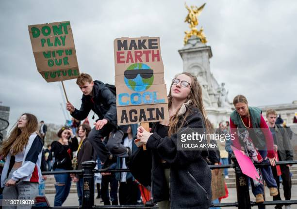Young demonstrators leave from the Queen Victoria Memorial as they take part in the Global Strike 4 Climate protest march outside of Buckingham...