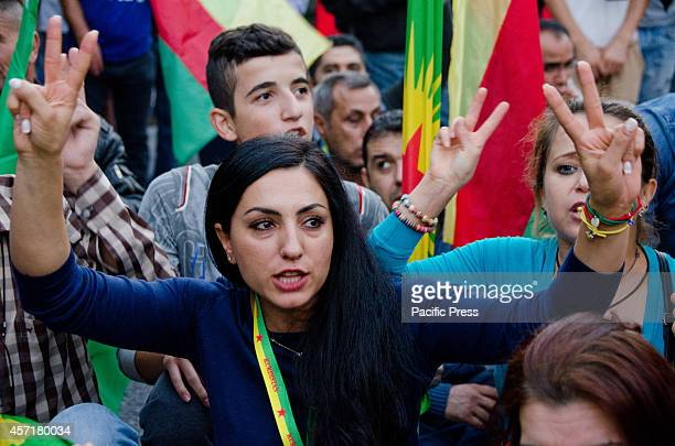 Young demonstrators make the 'victory' sign and shout slogans against Turkey and ISIS standing in front of the Greek parliament Kurdish people that...