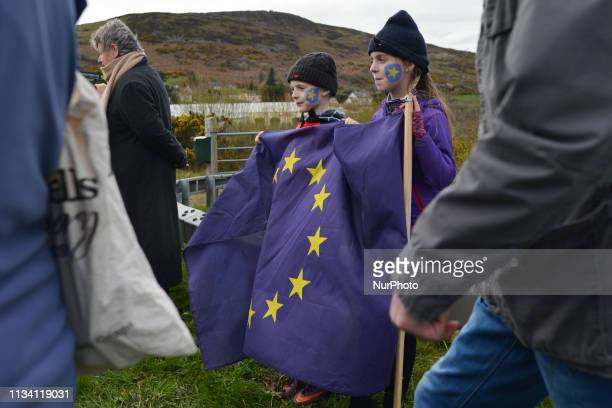 Young demonstrators participate in a Border Communities Against Brexit protest along the border between the Republic of Ireland and the United...