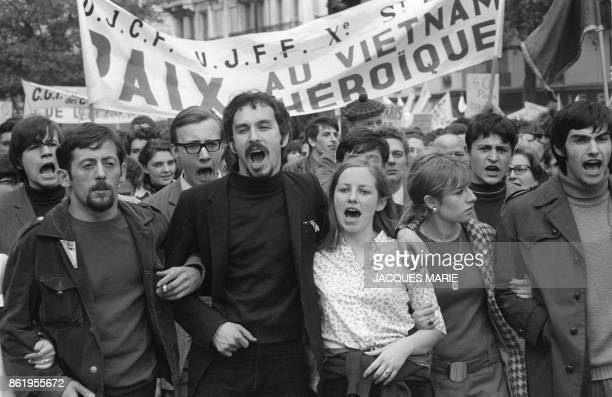 Young demonstrators shout slogans against the Vietnam war during the traditional May Day rally in Paris 01 May 1968