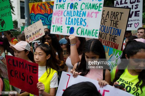 "Young demonstrators take part in the ""Global Climate Strike"" protest in Bangkok on September 20, 2019. - Children across Asia and the Pacific..."