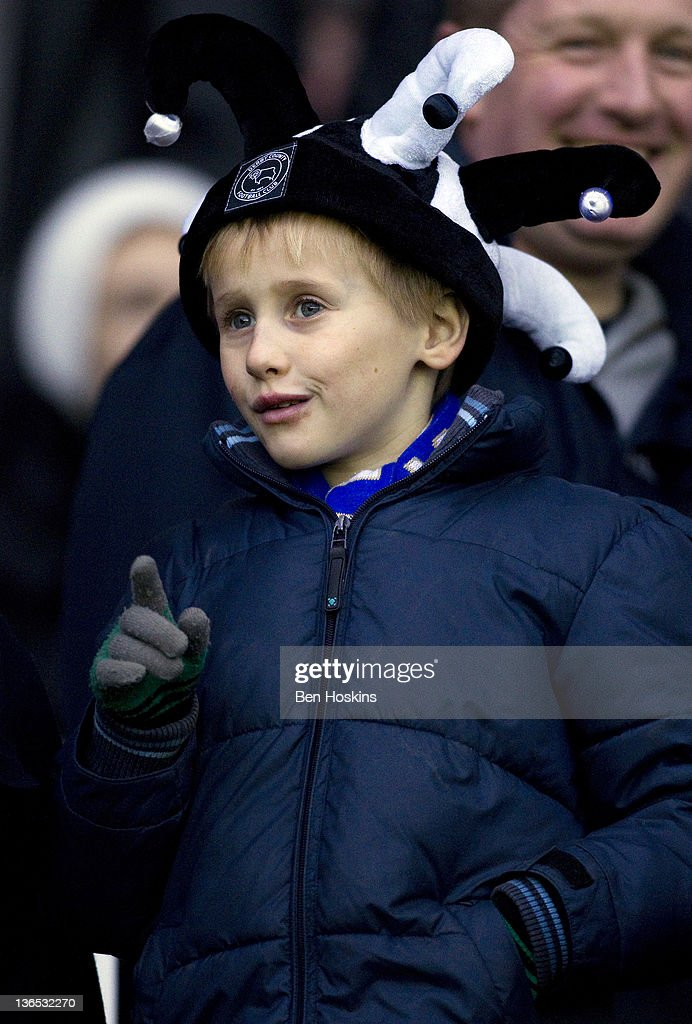 A young Derby fan looks on prior to the FA Cup sponsored by Budweiser Third Round match between Derby County FC and Crystal Palace FC at Pride Park on January 7, 2012 in Derby, England.