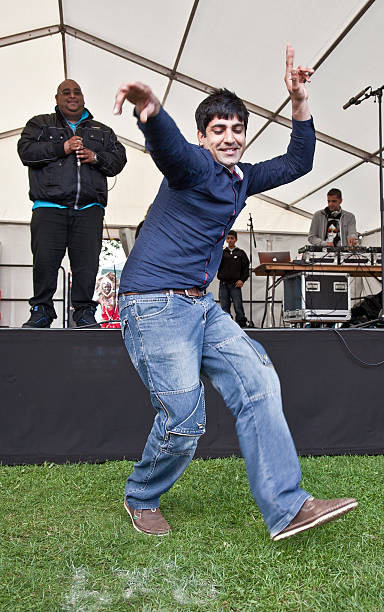 Young desi man dancing in Bhangra style; Edinburgh Mela