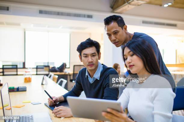 young design team in an informal meeting - east asian culture stock photos and pictures
