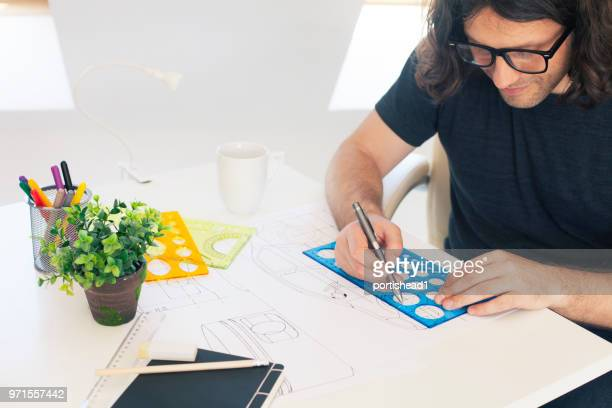 Young designer in a sunny office