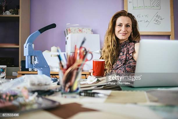 Young designer in her working studio