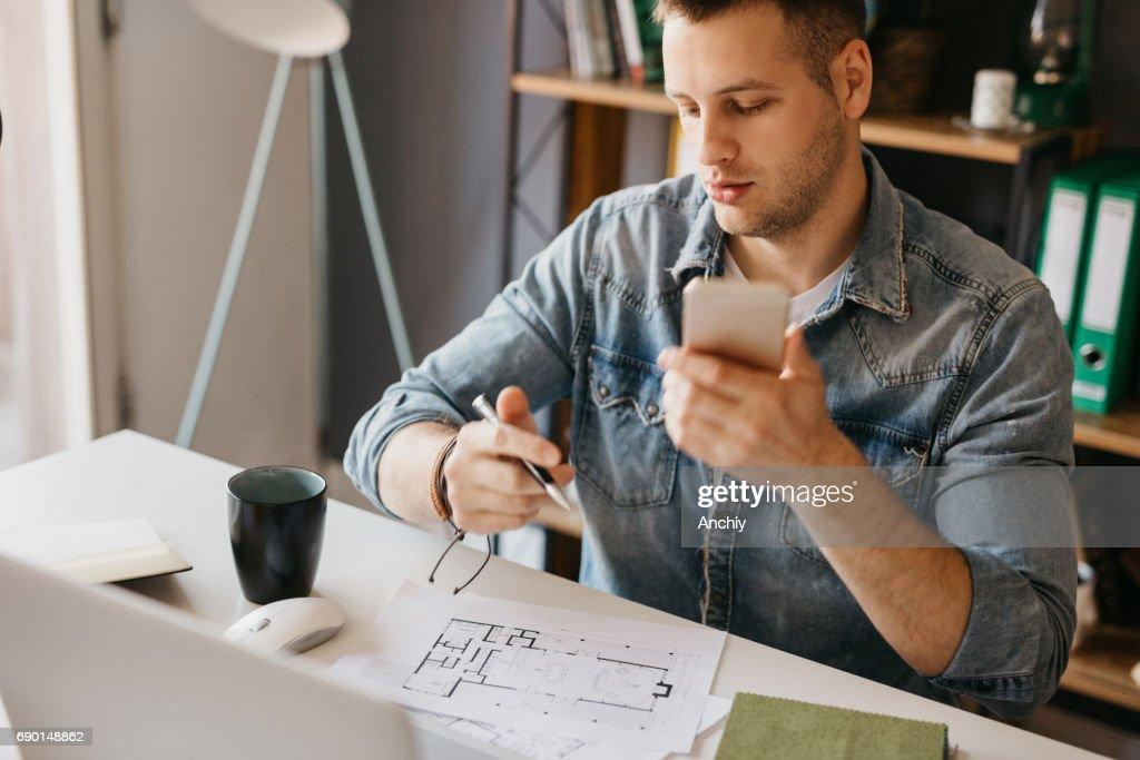 home office multitasking. Young Designer Multitasking In The Home Office : Stock Photo I