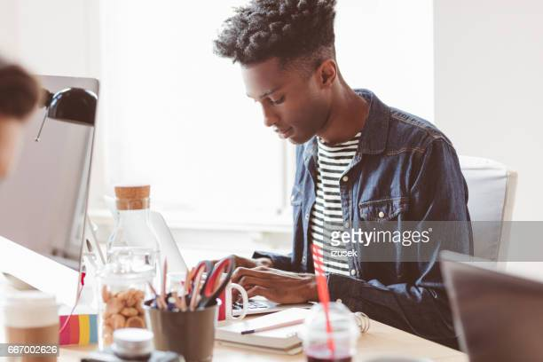Young designer working at creative office