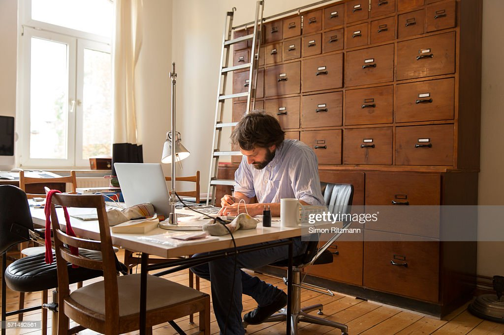 Young designer working in home office. : Stock Photo