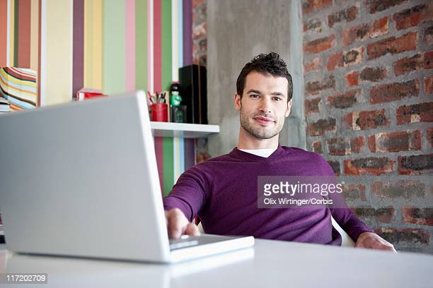 young designer working in studio - design occupation stock pictures, royalty-free photos & images