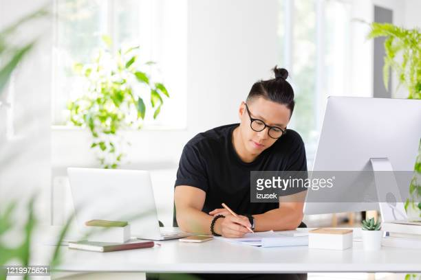 young designer working in the eco-friendly office - inventor stock pictures, royalty-free photos & images