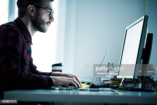 Young designer working on computer