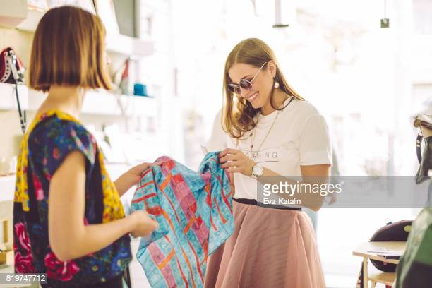 young designers working together in their store - gift shop stock pictures, royalty-free photos & images