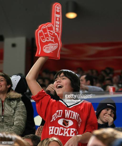 A young Detroit Red Wings fan holds up a foam finger during a NHL game against the Nashville Predators on March 15 2008 at Joe Louis Arena in Detroit...