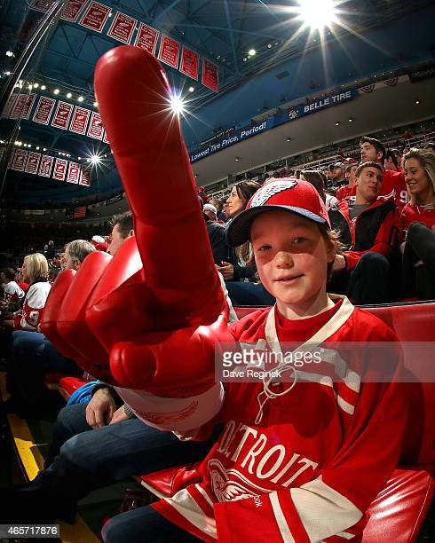 A young Detroit Red Wings fan holds up his teams foam finger during a NHL game against the Edmonton Oilers on March 9 2015 at Joe Louis Arena in...