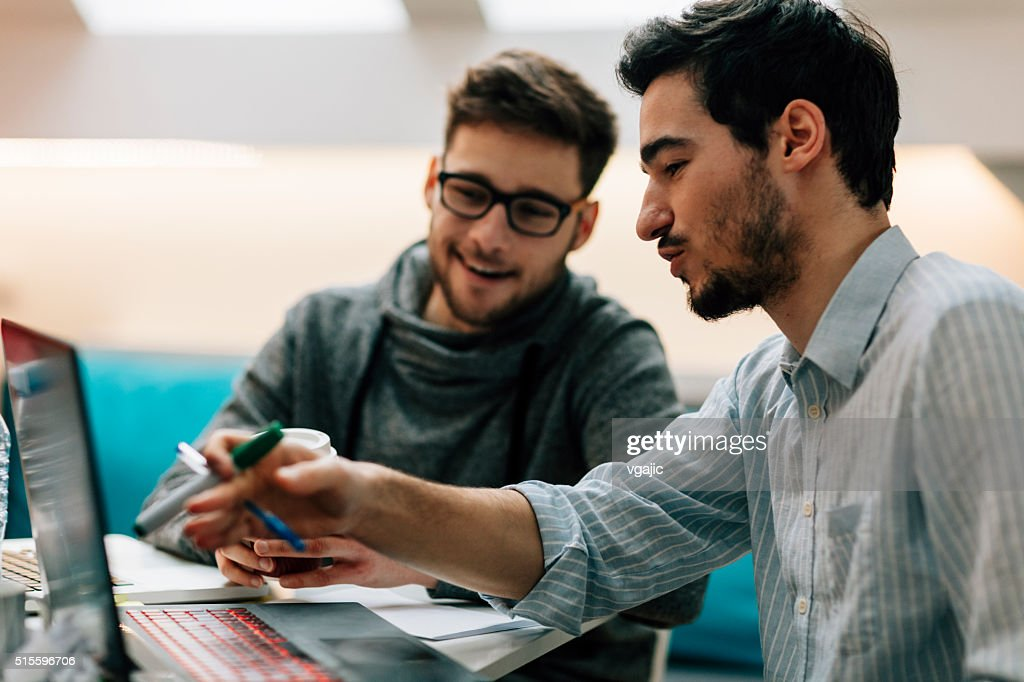 Young Developers Working In Office : Stock Photo